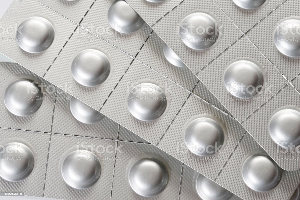 Silver blister packs of pills stock photo