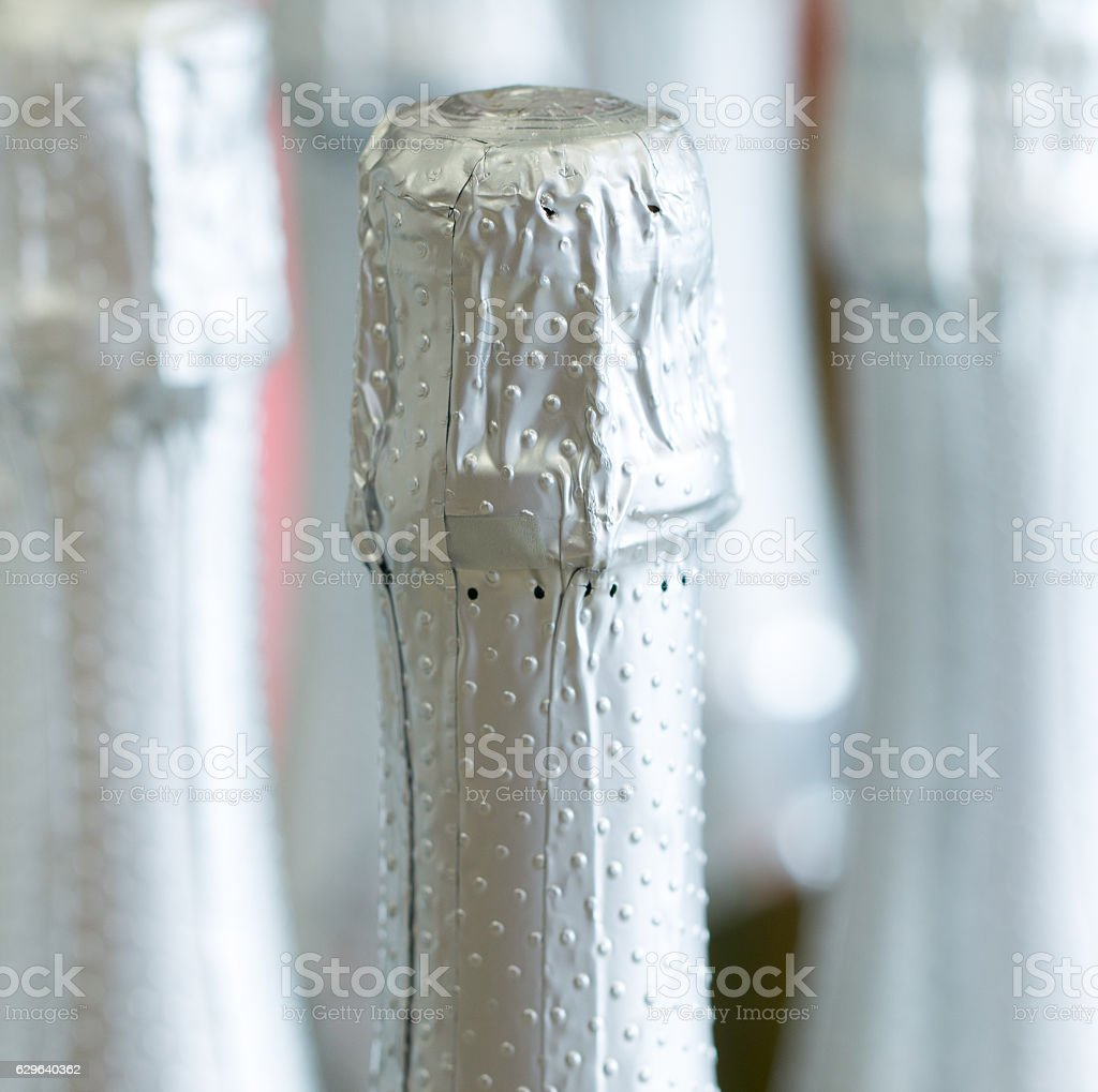 Silver  bottle necks and top caps at standing the stock photo