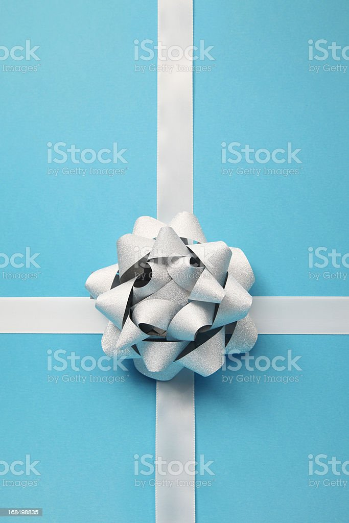 Silver bow on blue royalty-free stock photo