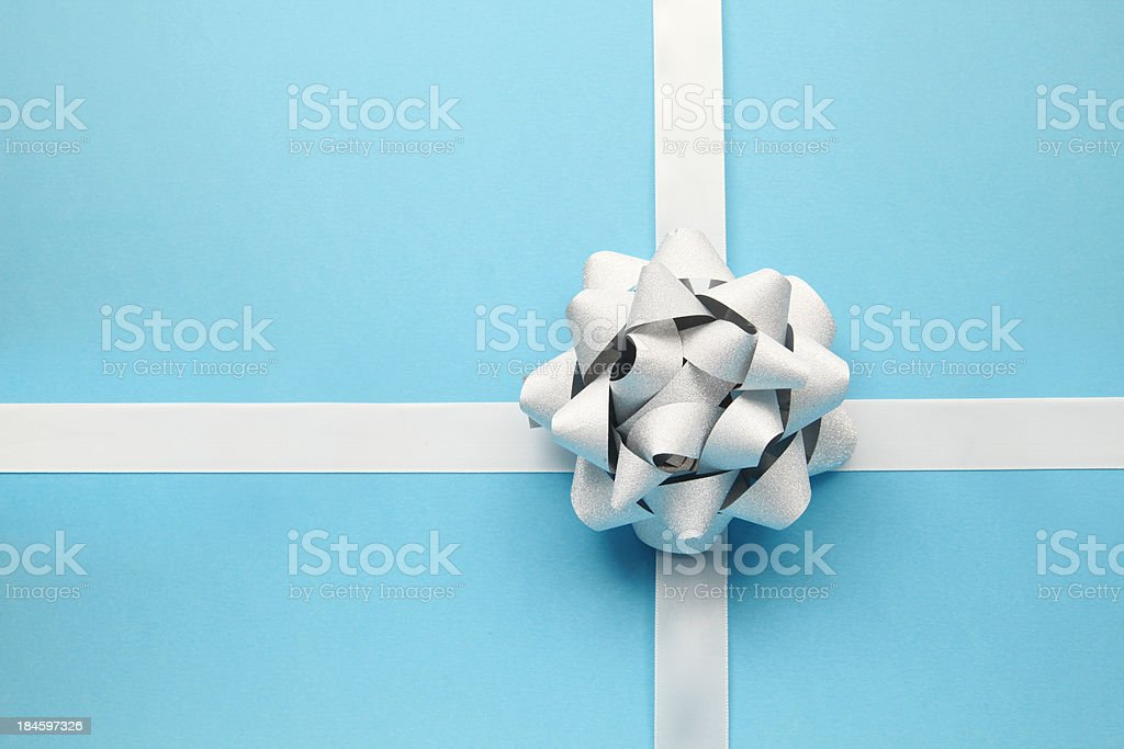 Silver bow on blue stock photo