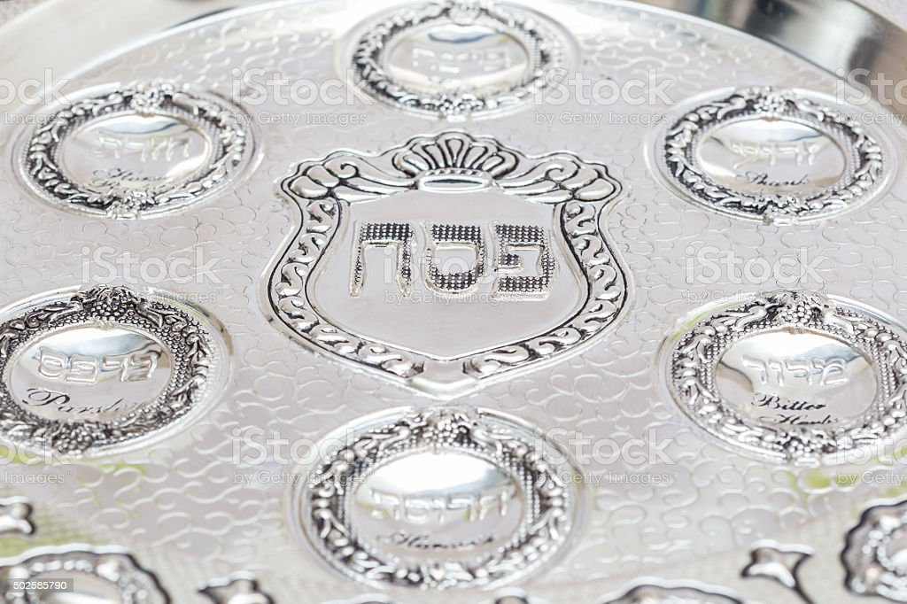 silver bowl for Passover. Seder Plate. Text - Passover stock photo