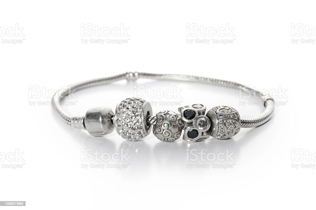 Silver bracelet with different beads stock photo
