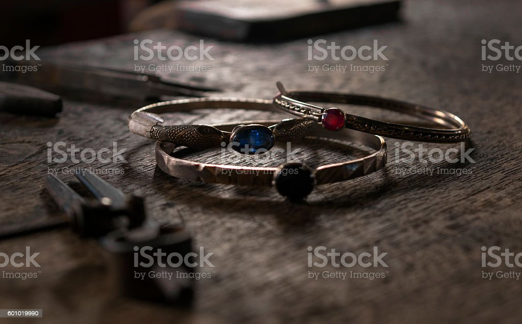 Silver bracellets with colourfull stones stock photo