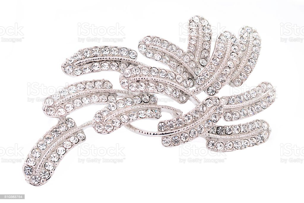 silver brooch with diamonds on a white background stock photo