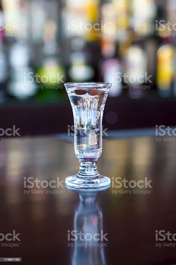 Silver Bullet  shot cocktail on the classic black bar table royalty-free stock photo