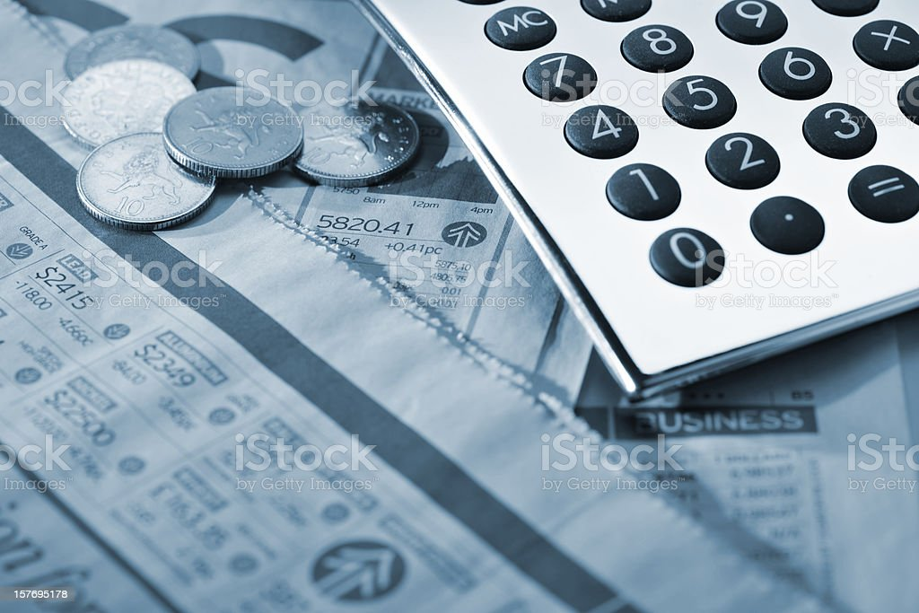 silver calculator and coins on financial newspaper royalty-free stock photo