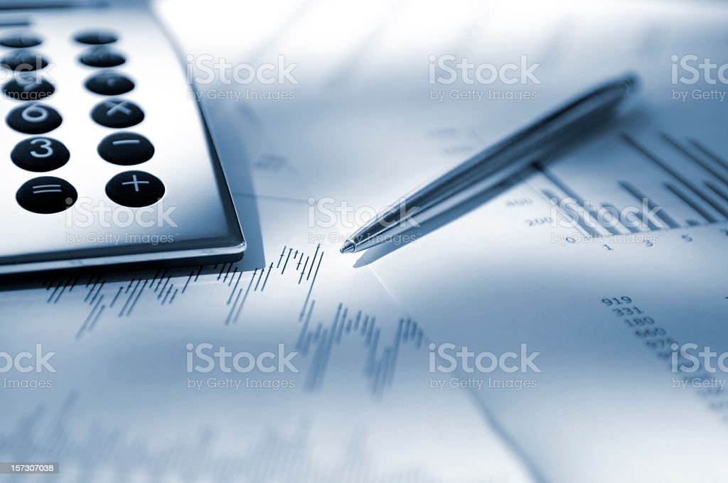 Silver Calculator, Pen and Graphs royalty-free stock photo