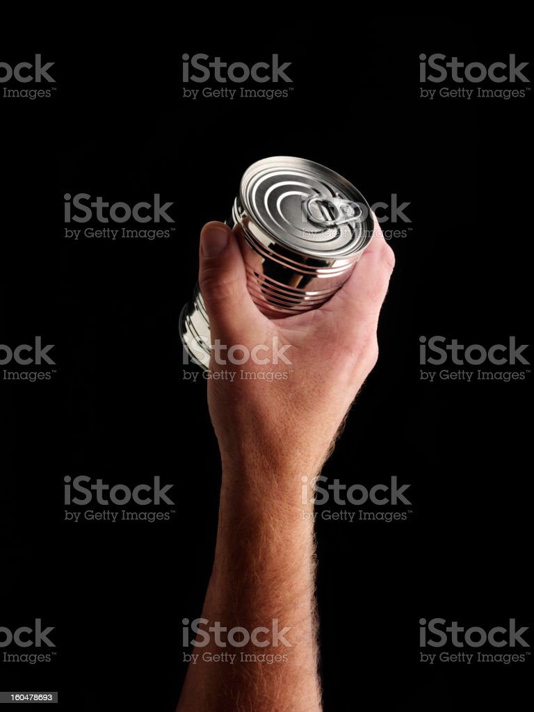 Silver can in hand royalty-free stock photo