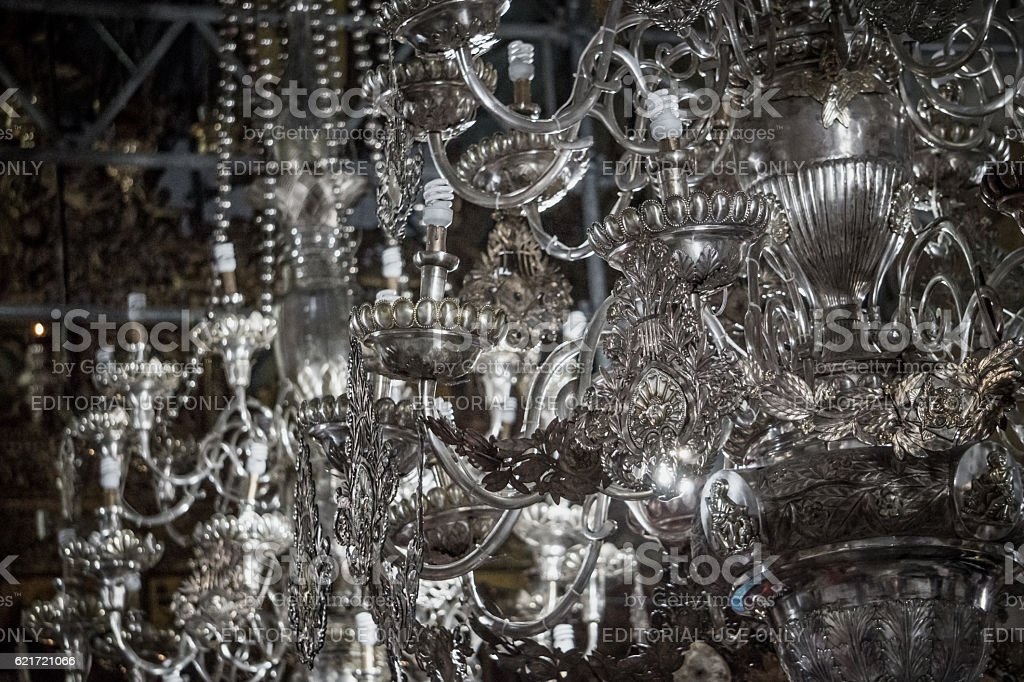 Silver candelabra in the ancient Church stock photo