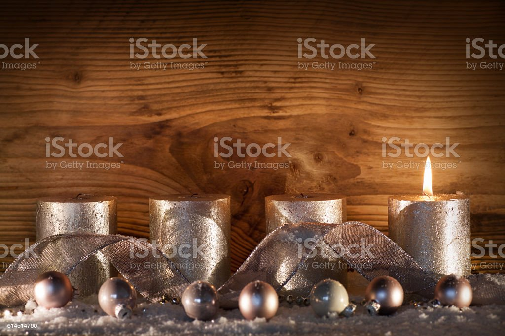 Silver candles for the 1. Advent stock photo