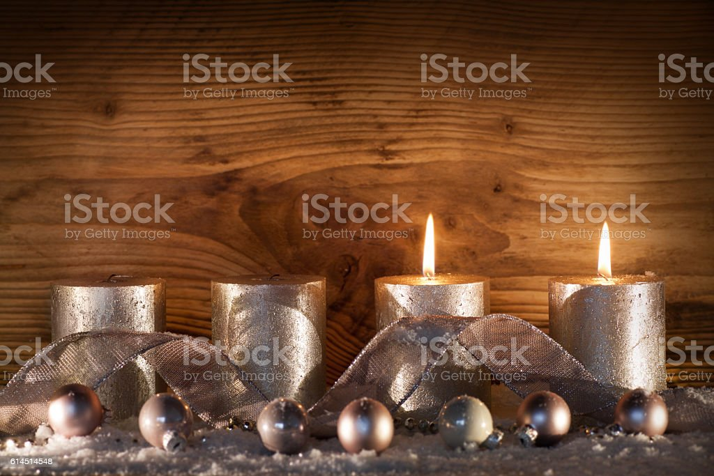 Silver candles for the 2. Advent stock photo