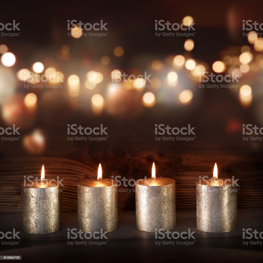 Silver candles in front of a festive background stock photo