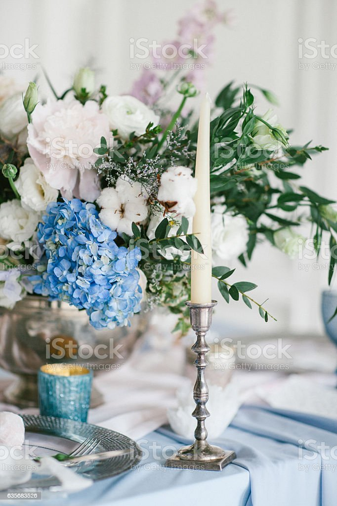 Silver candlestick as element of festive table wedding decorations. stock photo