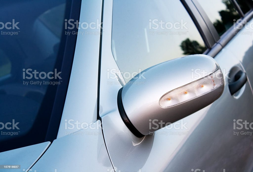 silver car , fokus on the mirror with indicator stock photo