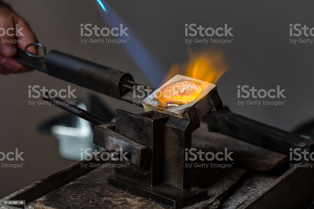 Silver Casting from Crucible to Metal Mold stock photo