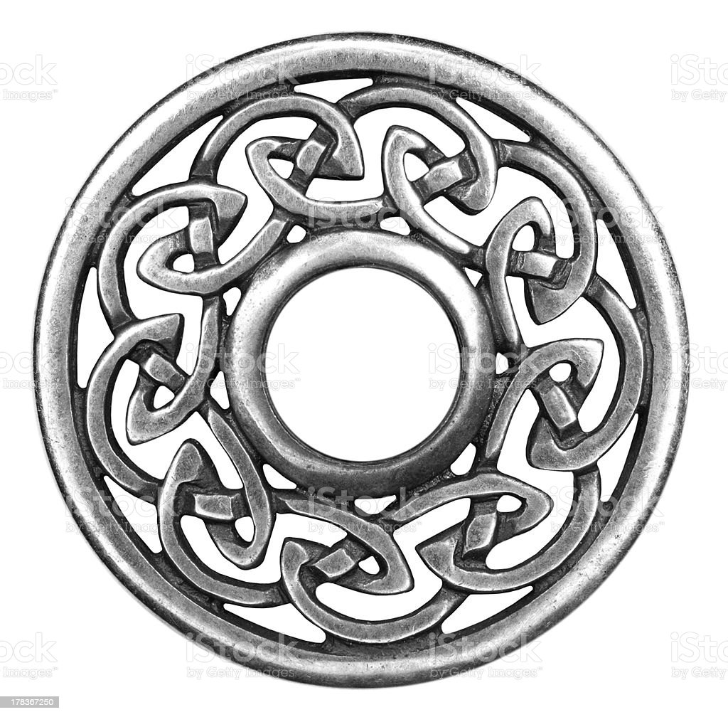 Silver celtic brooch in isolated on white royalty-free stock photo