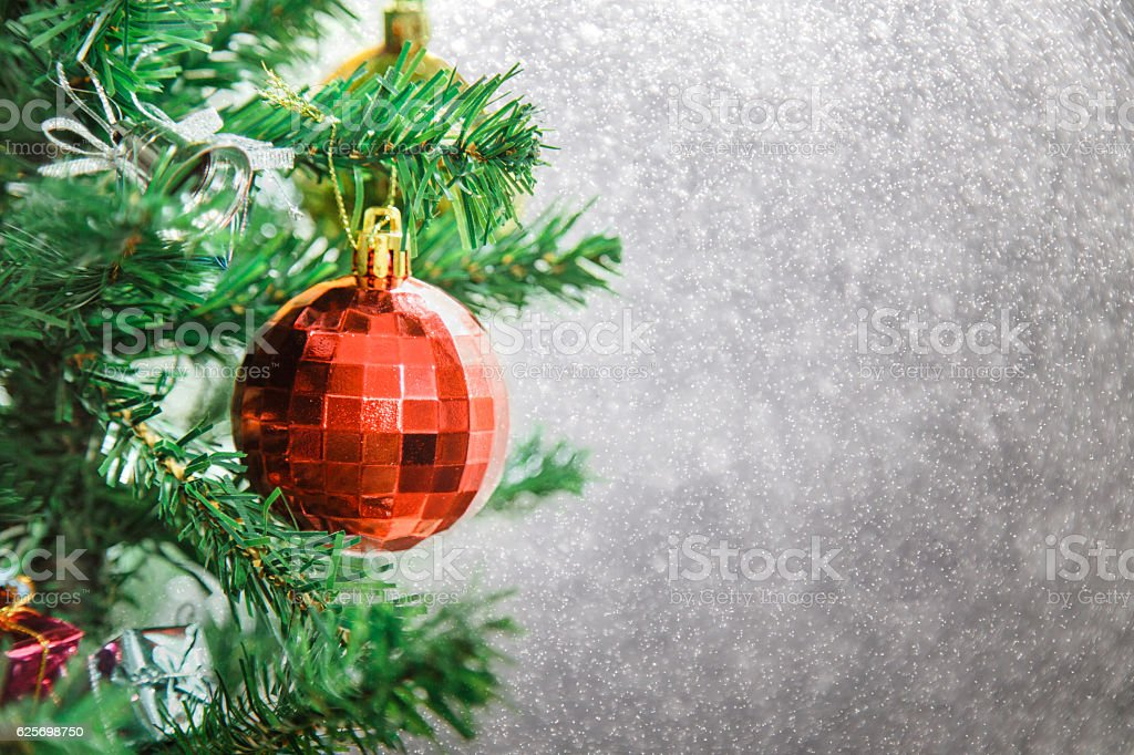 Silver Christmas background of de-focused lights with decorated tree stock photo