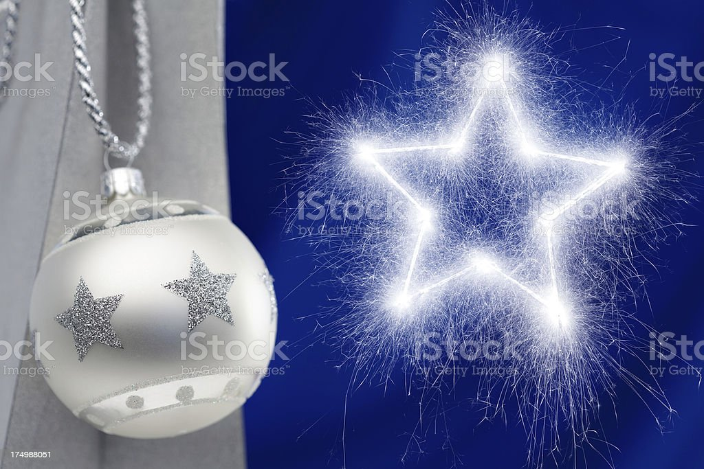 silver christmas bauble and sparkler royalty-free stock photo