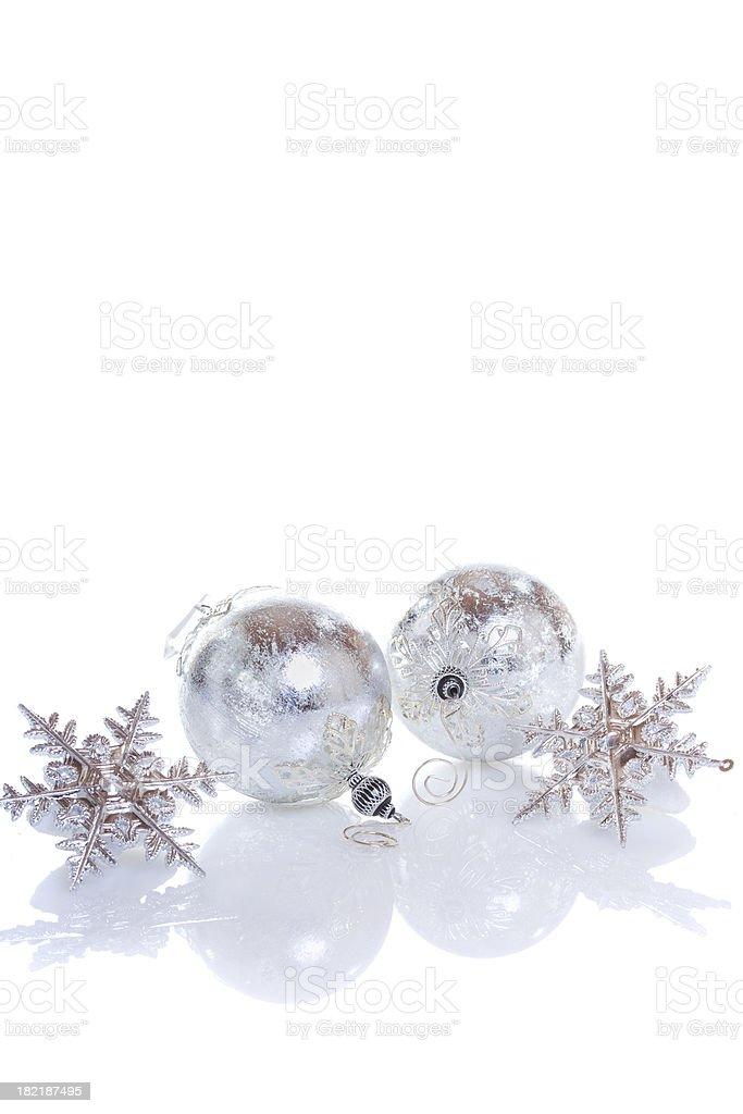 Silver christmas baubles on white background royalty-free stock photo