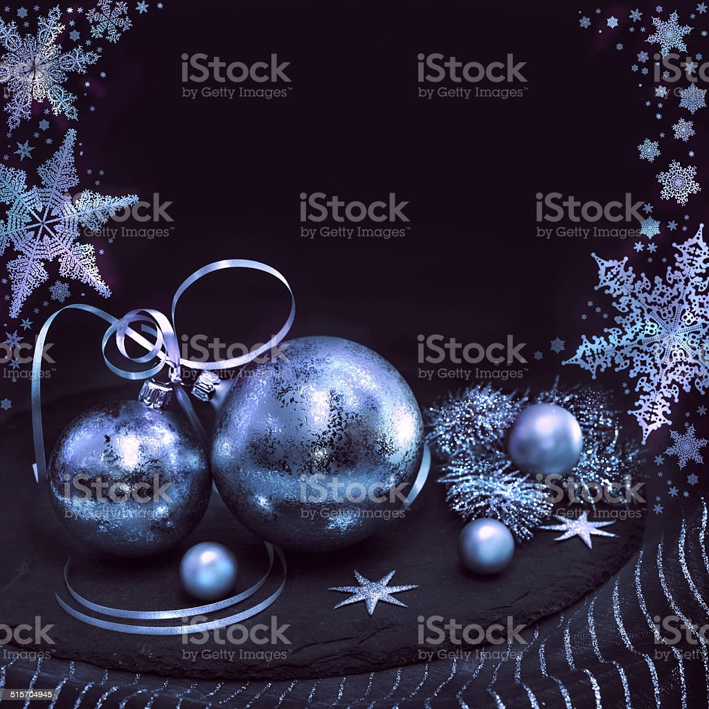 Silver Christmas decorations on winter background stock photo