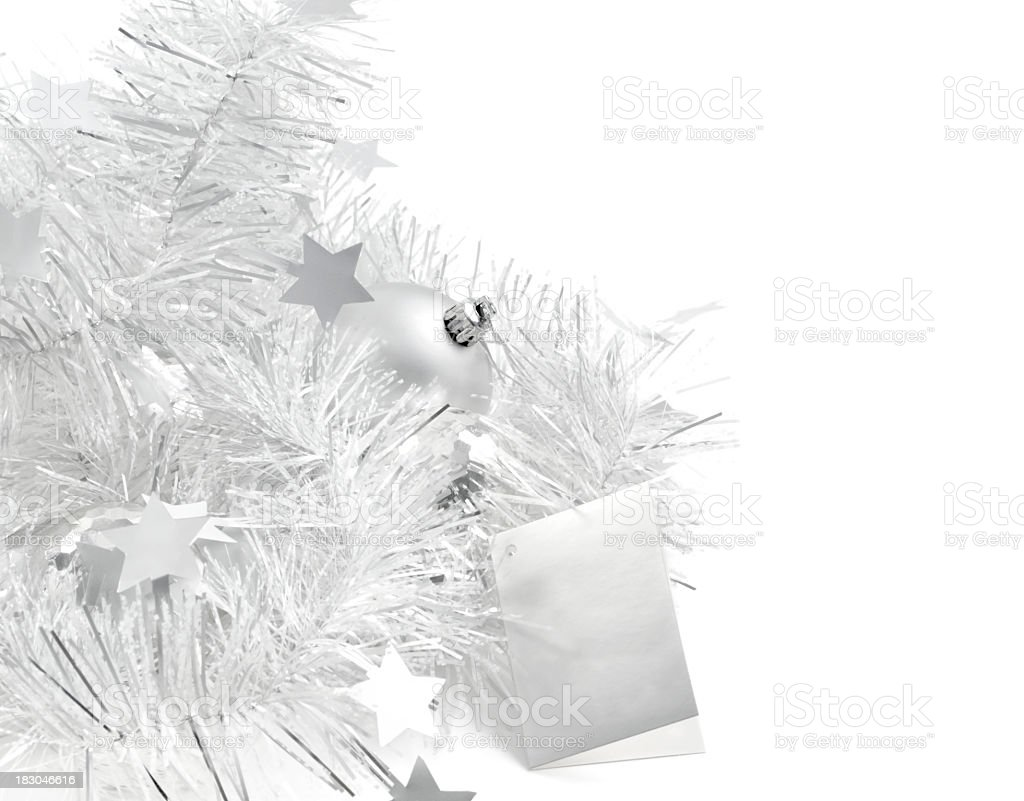 Silver Christmas decorations with gift tag on white stock photo