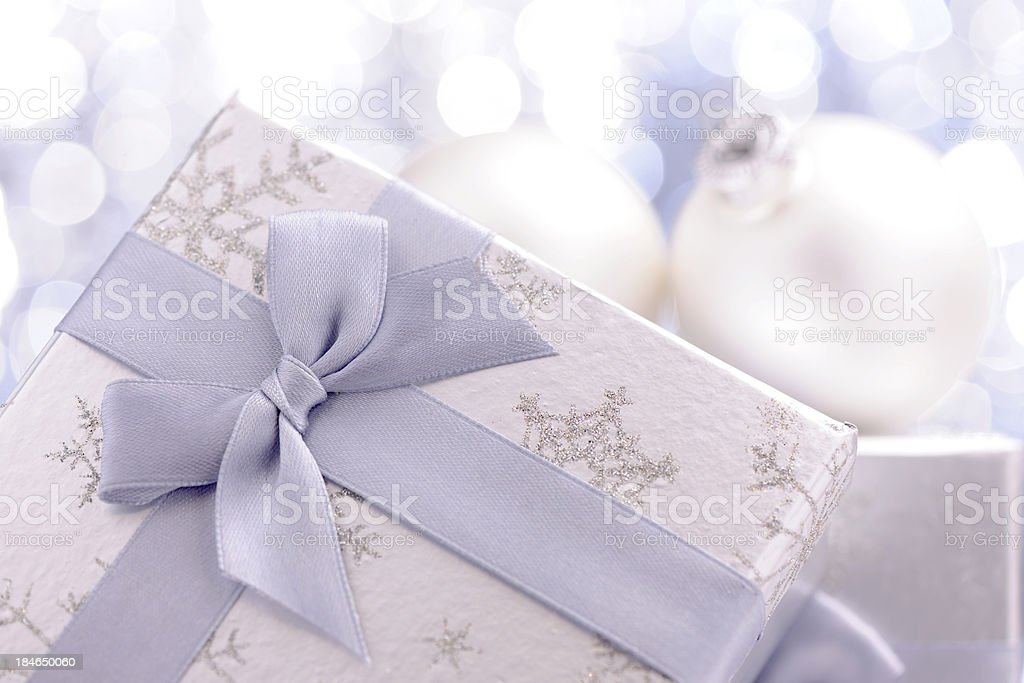 Silver christmas present with illuminated background royalty-free stock photo