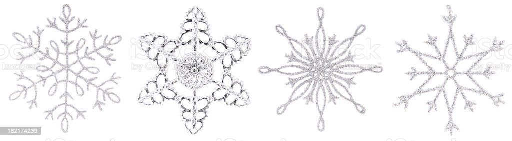 Silver Christmas snowflakes in a row. stock photo