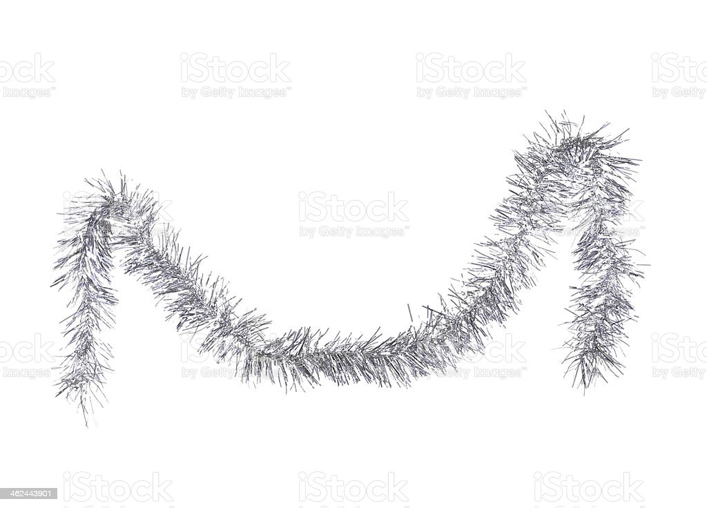 Silver Christmas tinsel suspended on isolated background stock photo