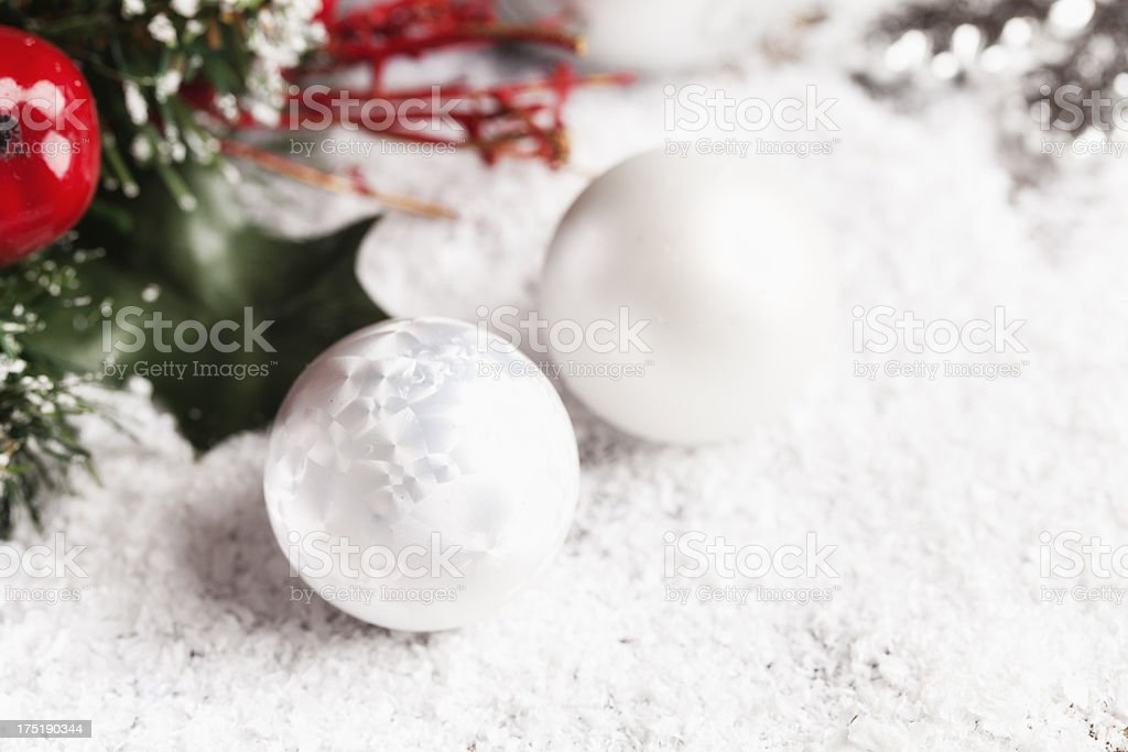 silver christrmas bauble on snow stock photo