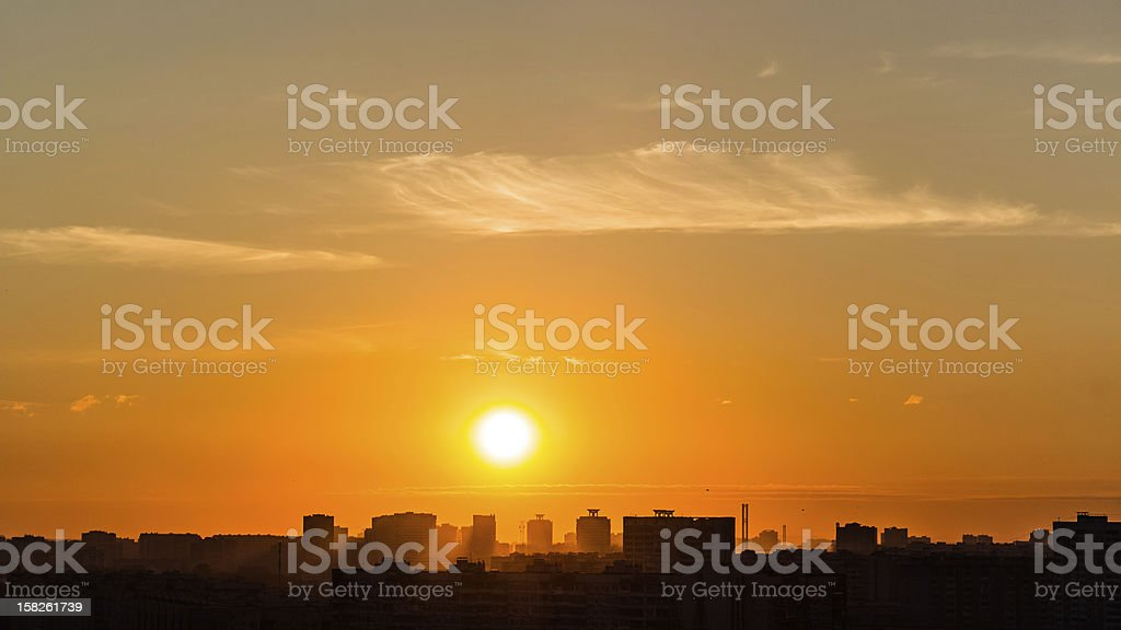 Silver clouds  and Sun Over Houses royalty-free stock photo