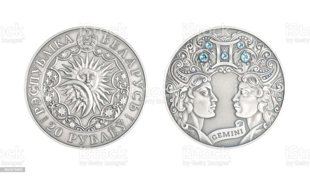 Silver coin Astrological sign Gemini stock photo