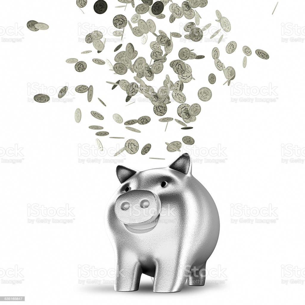 Silver coins falling into a piggy bank stock photo