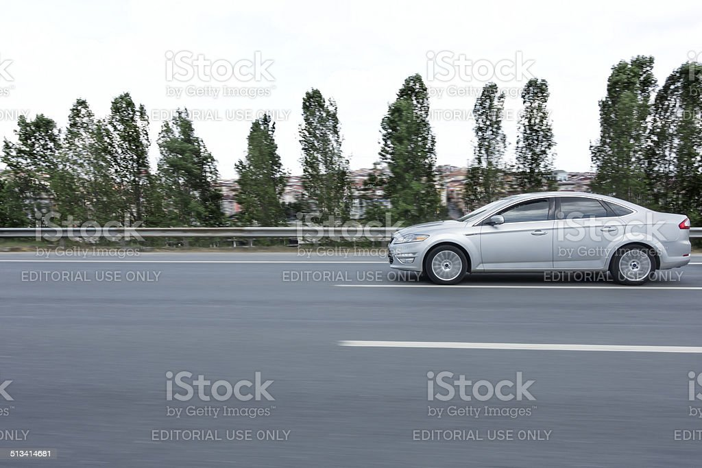 silver color car moving on highway stock photo