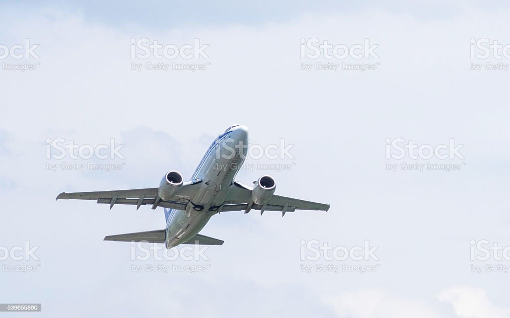 Silver Colored Airplane in the Flight stock photo