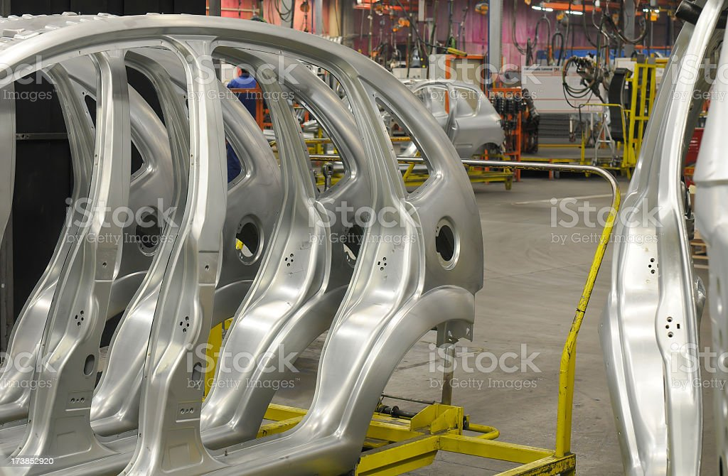 Silver colored car parts showing in car industry royalty-free stock photo