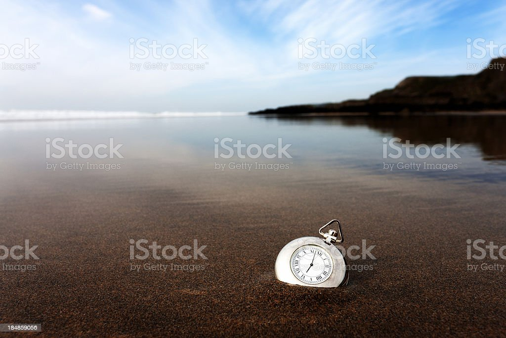 Silver compass on the beach stock photo