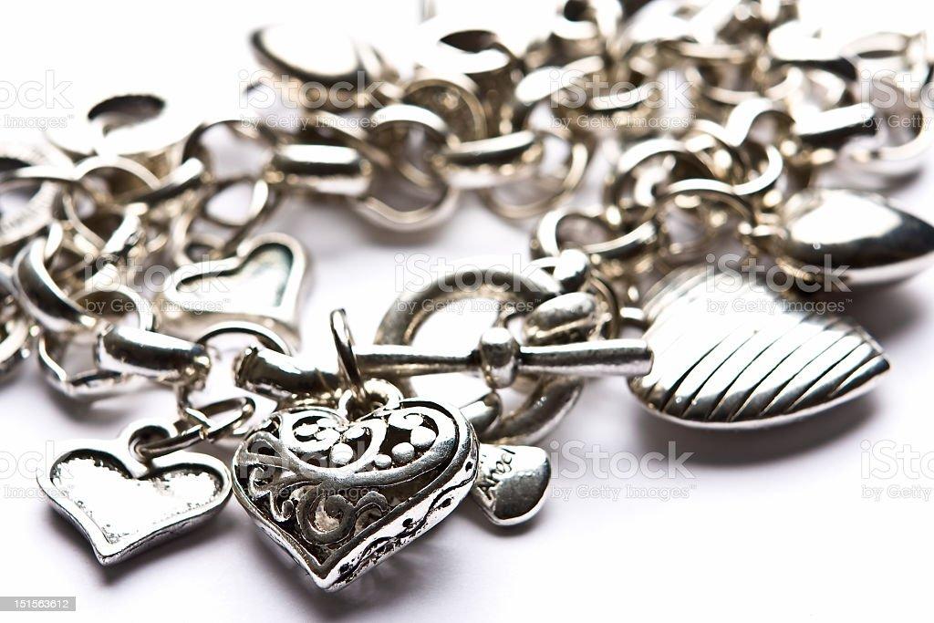 Silver costume jewelry heart charm bracelet stock photo