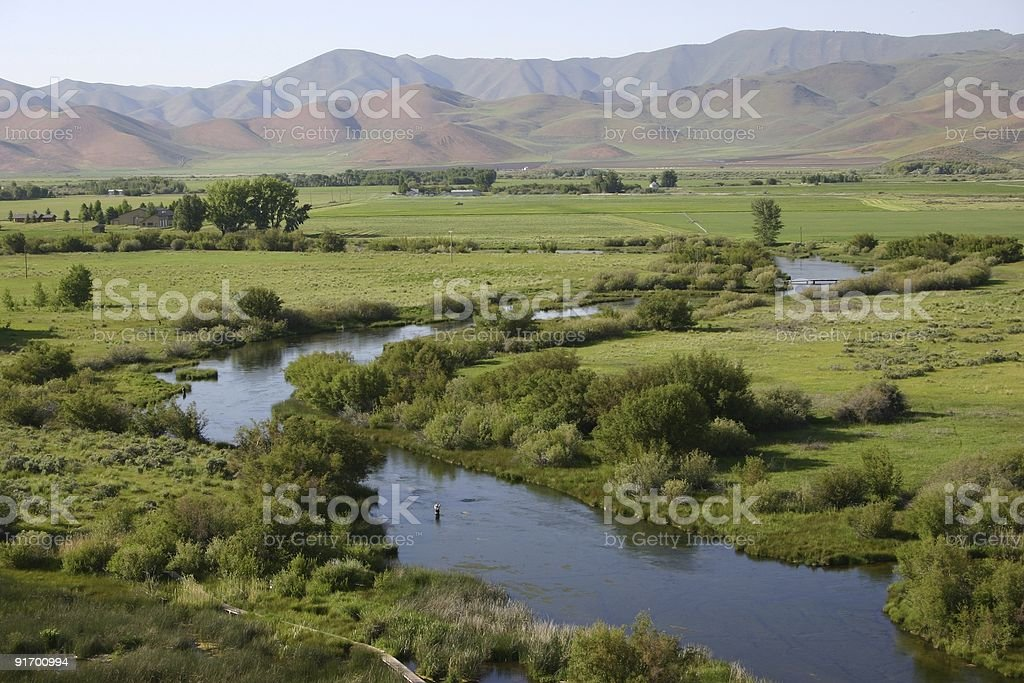 Silver Creek in Idaho winding through green paddocks stock photo