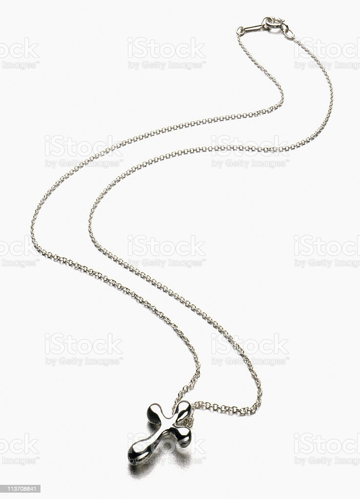 Silver Cross Necklace cut out on white stock photo