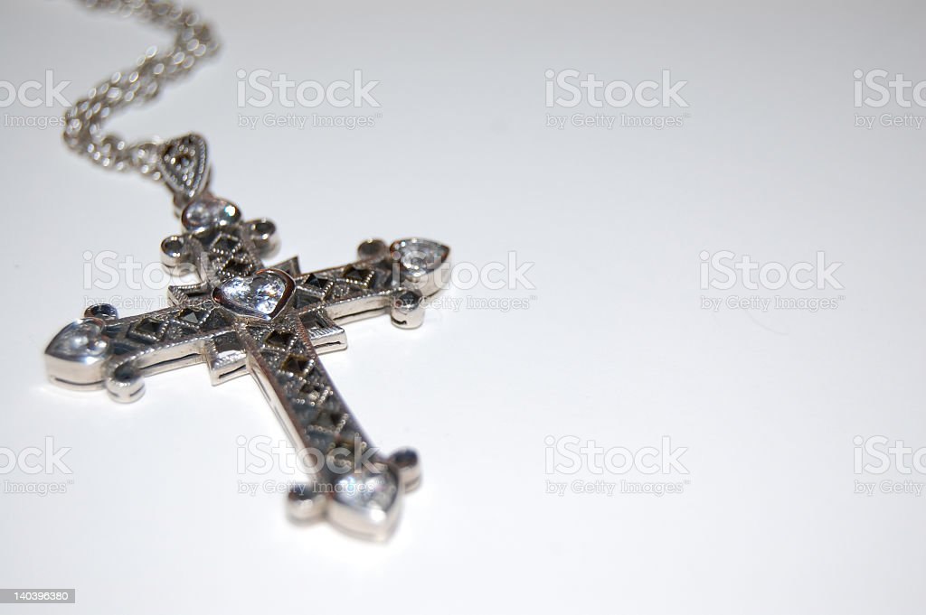 Silver cross with gemstone embellishment on chain stock photo