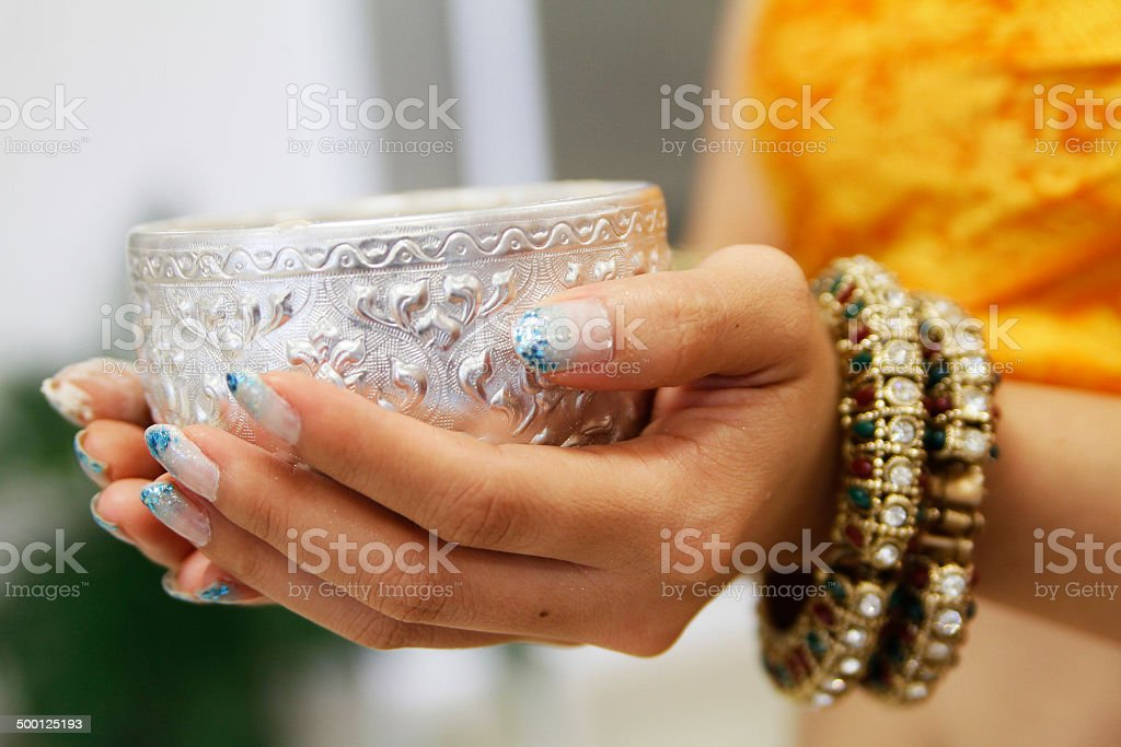 Silver cup in hand royalty-free stock photo