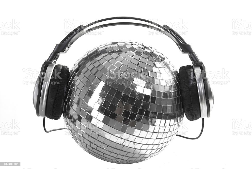 Silver disco ball wearing headphones isolated on white stock photo