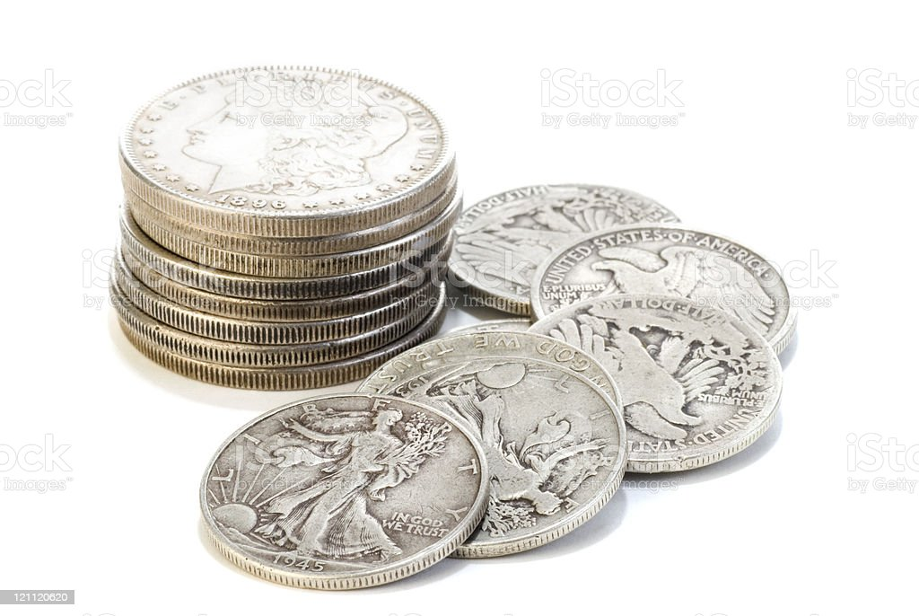 Silver Dollars and Fifty Cent Coins stock photo