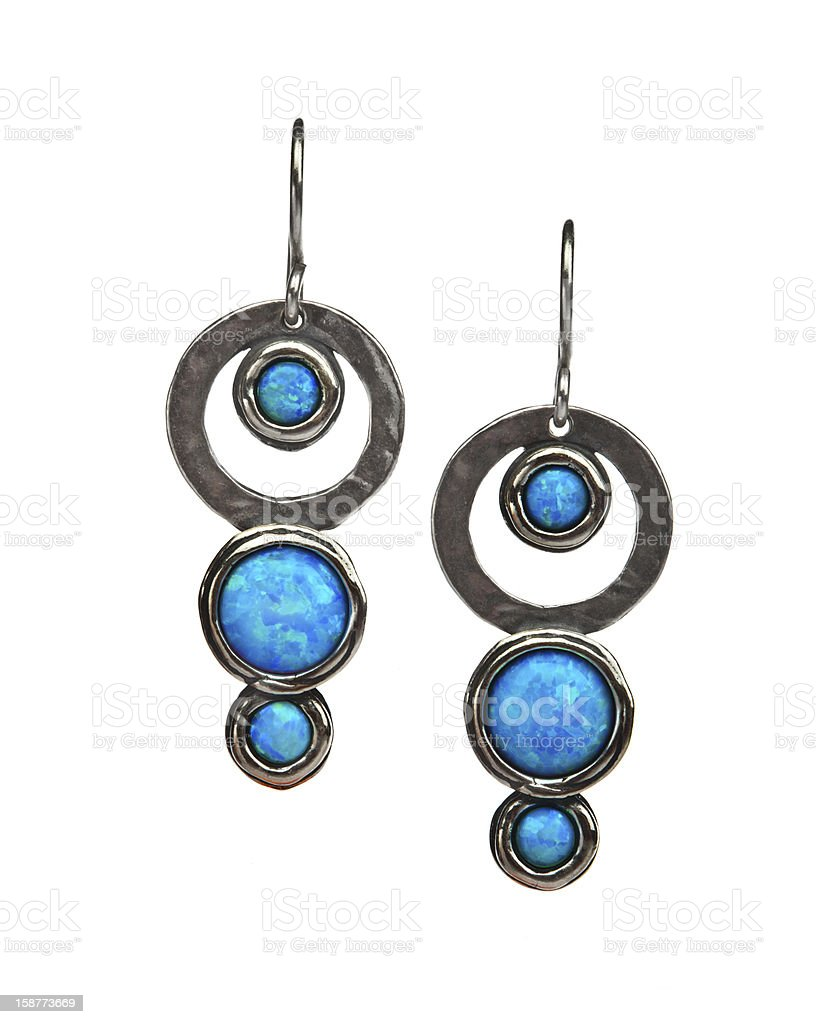 Silver earrings with opal. stock photo