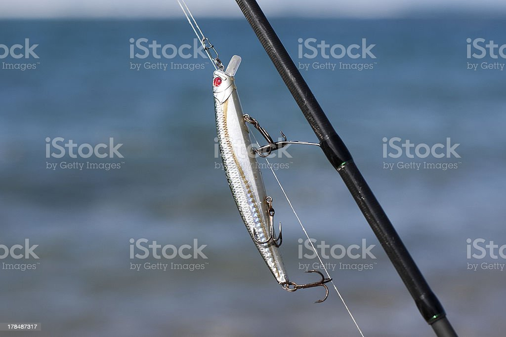 Silver fishing lure in a rod royalty-free stock photo