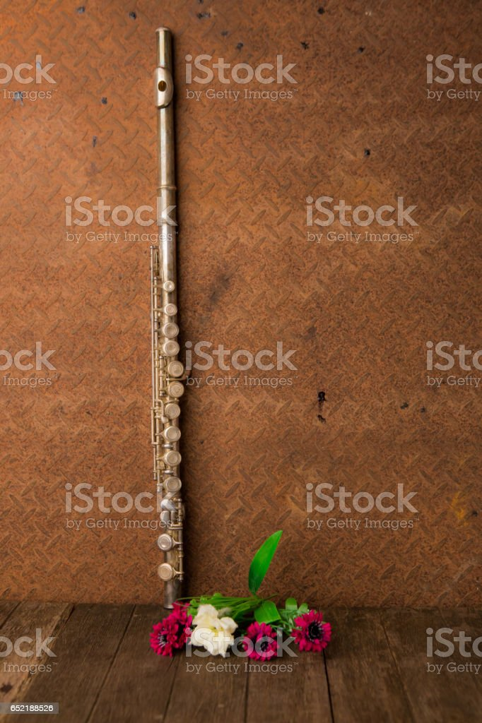 silver flute with old steel background with copy space stock photo
