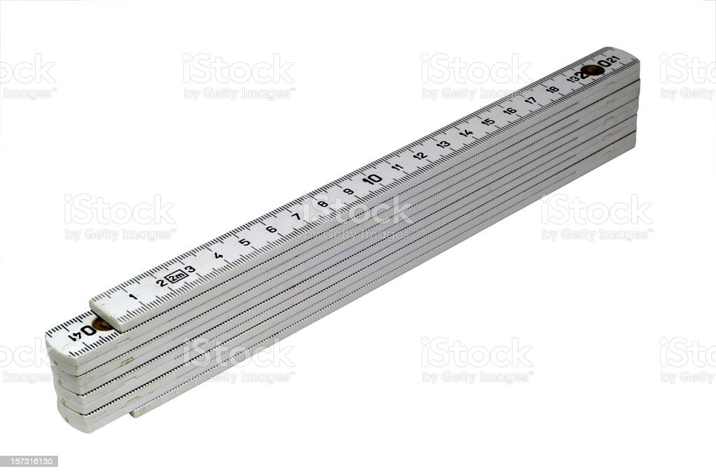 A silver folding ruler on a white background stock photo