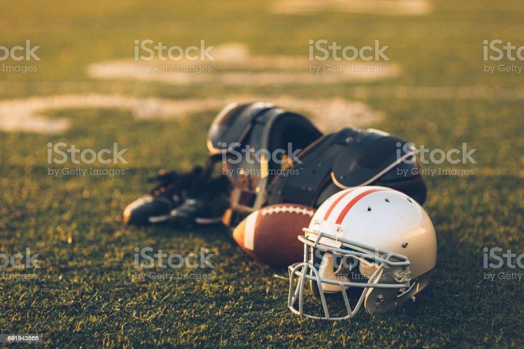 Silver Football Helmet on Field stock photo