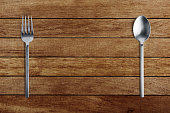 silver fork and spoon on wood
