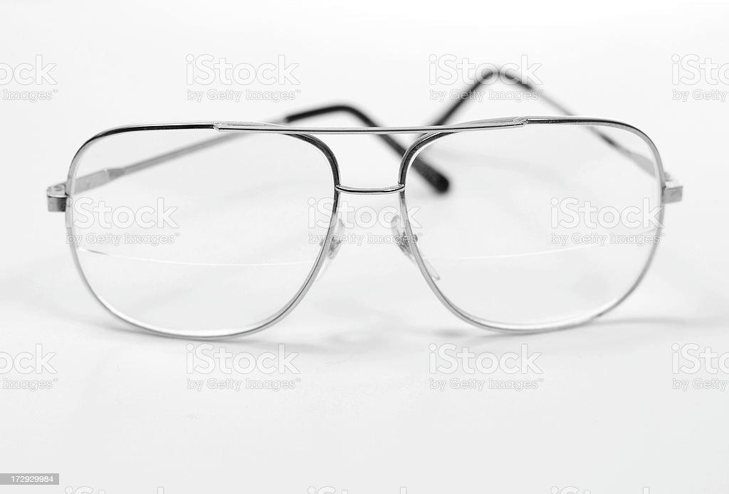 Silver framed eyeglasses on white royalty-free stock photo
